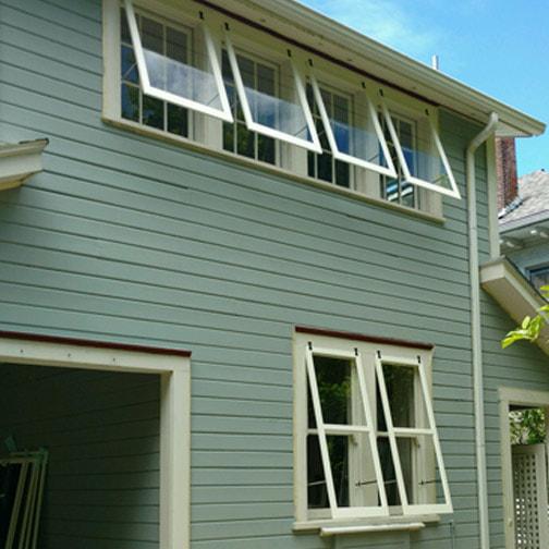 6 storm windows on home