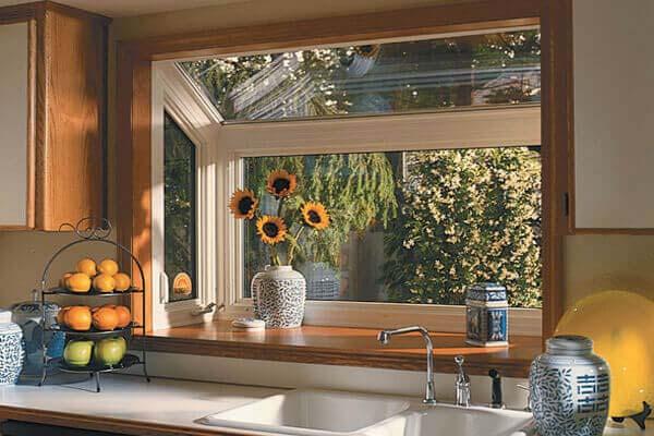 Sunflows In Garden Window