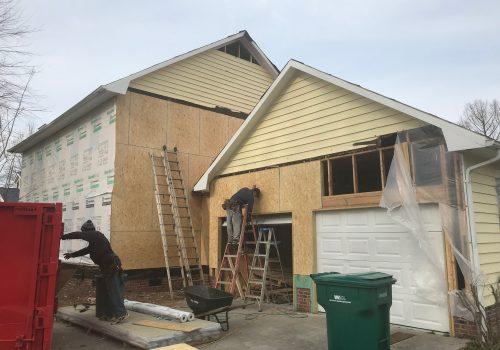 Installation of New Sheathing On Damaged House